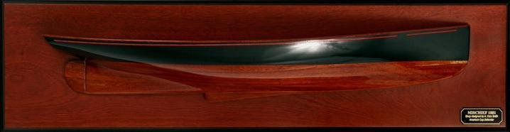Mischief ( 1879 ) half hull wooden hand crafted.  Hand-crafted plank-on-frame wood hull with dark green topsides, red cove stripe . Varnished stained wood hull.